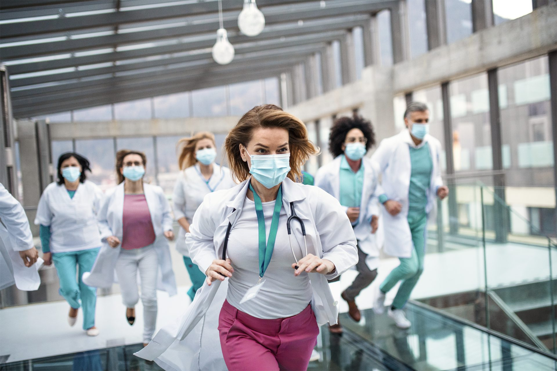 health professionals running in a building